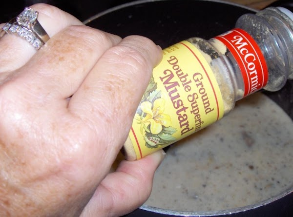 Add the dry mustard, salt and pepper, and Worcestershire sauce, stirring well to blend.