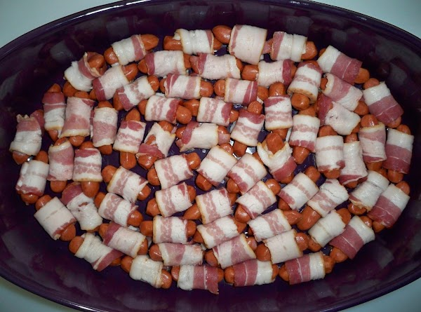 Preheat oven to 375°. Cut bacon into thirds and wrap each piece around little...