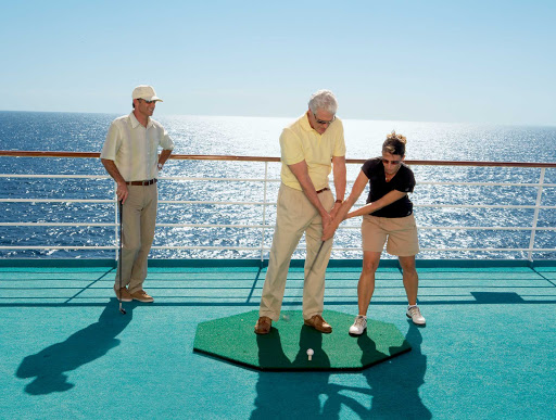 Receive golf tips from an expert trainer during your cruise on Crystal Serenity.