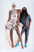 Guest designer Zama Mathe displays her creation with model Zime at the Vodacom Durban July virtual fashion programme