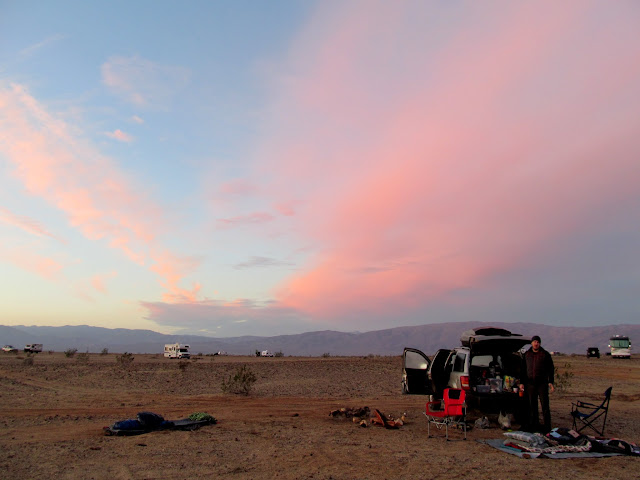 Colorful clouds over camp at sunrise