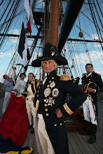 """Photo: Nelson stands on the poop of HMS Victory while the signalmen are hoisting his famous 'England Expects"""" message."""