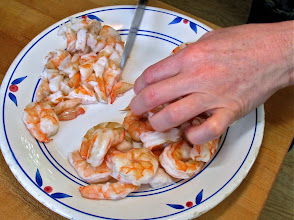 Photo: slicing the broiled shrimp into small pieces