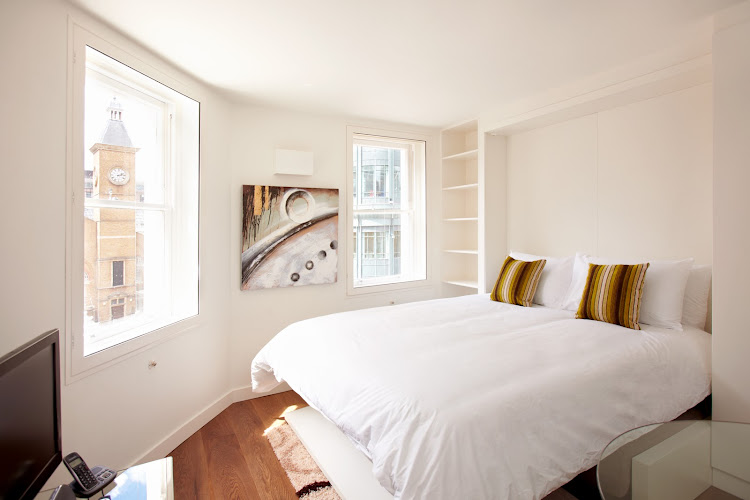 Bedroom at London City Apartments