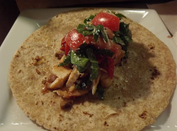 Put one tortilla on a plate, top with about ¼ cup chicken pieces; drizzle...