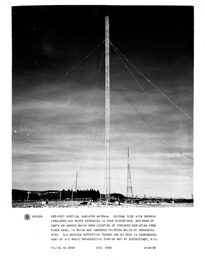 625-foot Vertical Radiator Antenna. General side view showing Insulated Guy Wires extending in four directions, and rows of Earth on ground which show location of trenches radiating from Tower Base, in which are imbedded thirteen miles of Grounding Wire. Old antenna Supporting Towers can be seen in background. Part of GE Radio Broadcasting Station WGY at Schenectady, N.Y.