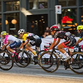 Speeding By by Garry Dosa - Sports & Fitness Cycling ( cyclists, racing, outdoors, race, road race, action, cycling, people, speed, women )