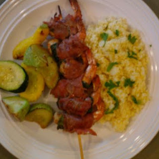 Grilled Prosciutto Wrapped Shrimp With Lemon Couscous