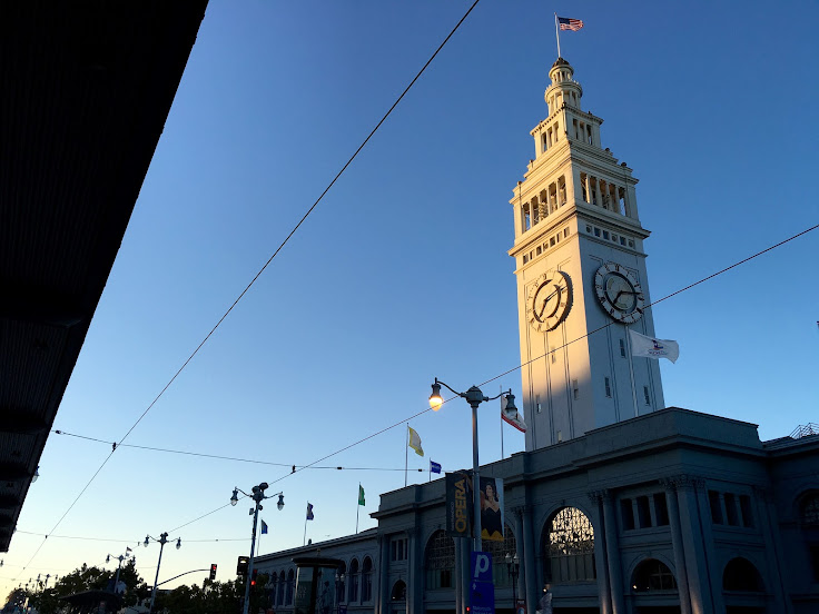 Late afternoon shot of the Ferry Building with the trolly station roof as a framing device.