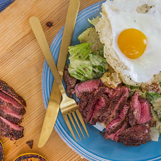 Rachael's Caesar Salad with Sliced Steak and Frico Egg.