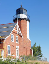 Photo: The present structure was built in 1871 using a design that had previously been used for Chambers Island Lighthouse in Wisconsin; and McGulpin Point Light in 1868. The octagonal brick light tower is ten feet in diameter, with walls 12 inches thick.