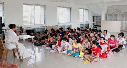 Photo: Bramhacharini Varshaben taking Prathmik class