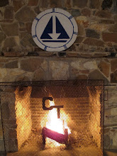 Photo: Fireplace of Tasnena Lodge with the Camp Toccoa symbol above.