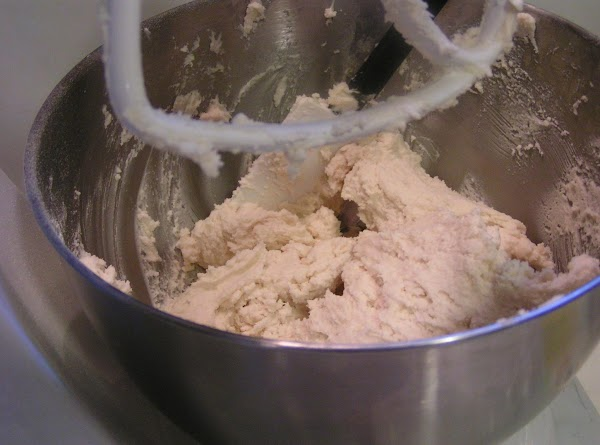 Add the dry ingredients to the creamed mixture one third at a time, mixing...