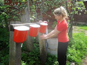 Photo: Liz washing hands at outdoor sink
