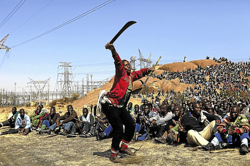 While they bravely put up a fight for decent wages, the striking Lonmin mineworkers at Marikana also killed fellow workers, only themselves to be killed by police firepower. /Alon Skuy