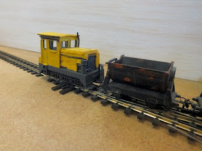 "Photo: 016 A rather rugged and workmanlike industrial diesel loco that Tom Husband has scratchbuilt onto the popular Bachmann ""brick"" chassis. The skip is an N scale Minitrix one unless I am mistaken. They are somewhat larger than the Roco/Minitrains type but have the advantage that they are heavier and therefore more stable ."