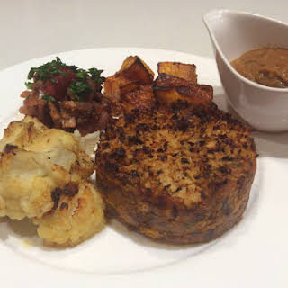 """""""Meatloaf"""" with cauliflower cheese and roasted vegetables."""