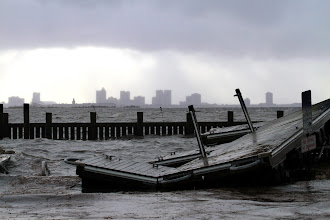 Photo: Seawater washes around a damaged pier in Pleasantville, N.J., with the skyline of Atlantic City in the background Tuesday, Oct. 30, 2012, the day after a powerful storm that was Hurricane Sandy made landfall nearby. (AP Photo/The Philadelphia Inquirer, David Swanson)  PHIX OUT; TV OUT; MAGS OUT; NEWARK OUT