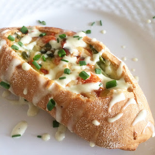 Spicy Baked Eggs in Bread Boats with a Jalapeno Cheese Sauce Recipe