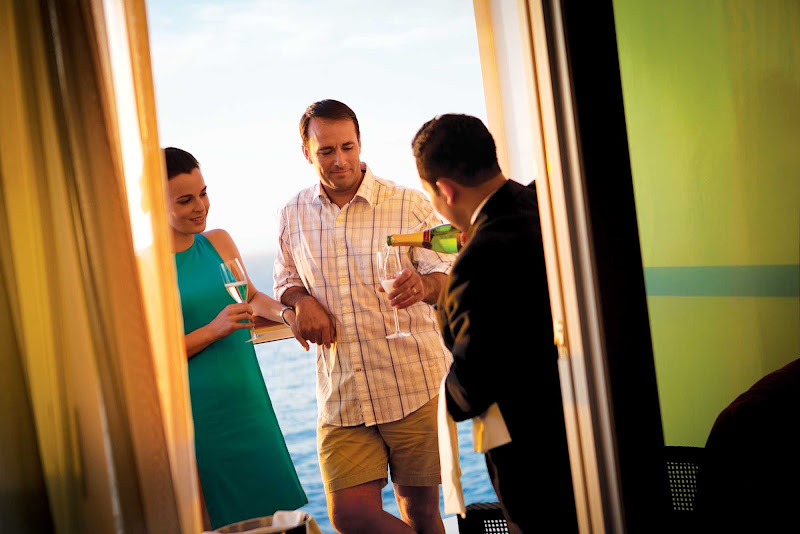 A butler serves Champagne to a couple in their suite on a Norwegian Cruise Line sailing.