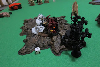 Photo: Turn 5 - end of turn - The Archon still stands, however he is unable to take down the Chaplain while Khorne Berzerkers continue to die all around.