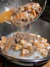 Photo: adding cooked ground pork and shrimp to bean thread