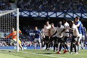David De Gea of Manchester United clears the ball off the goal line during the Premier League match between Everton FC and Manchester United at Goodison Park on April 21, 2019 in Liverpool, United Kingdom.