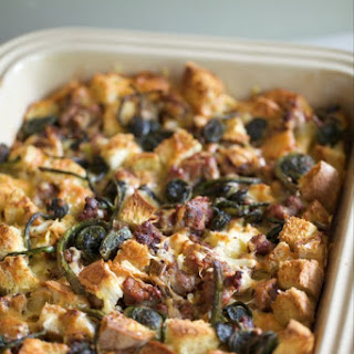 Savory Breakfast Bread Pudding with Fiddleheads, Sausage, Caramelized Leeks and Spring Onions, & Gruyere