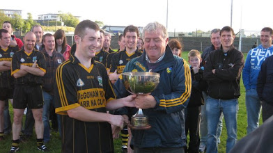 Photo: Jason Conroy accepts the Division 2 League Trophy 2010