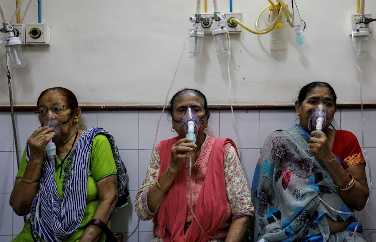 Women receive treatment for respiratory issues at a hospital in New Delhi, India, on November 2 2018. Picture: REUTERS/ANUSHREE FADNAVIS