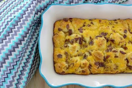 "Bacon Biscuit Breakfast Bake""Mixing pieces of bacon into the casserole gives it..."