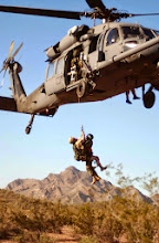 Photo: NEAR TUCSON, Ariz -- Pararescuemen from the 304th Rescue Squadron Portland Air National Guard Base, Ore., practice their rescue skills with an HH-60 Pave Hawk and crew from the 305th RQS at nearby Davis-Monthan Air Force Base. During the exercise here, the 304th RQS Airmen practiced rescue scenarios and desert survival skills.  (U.S. Air Force photo by Tech. Sgt. Ruby Zarzyczny)