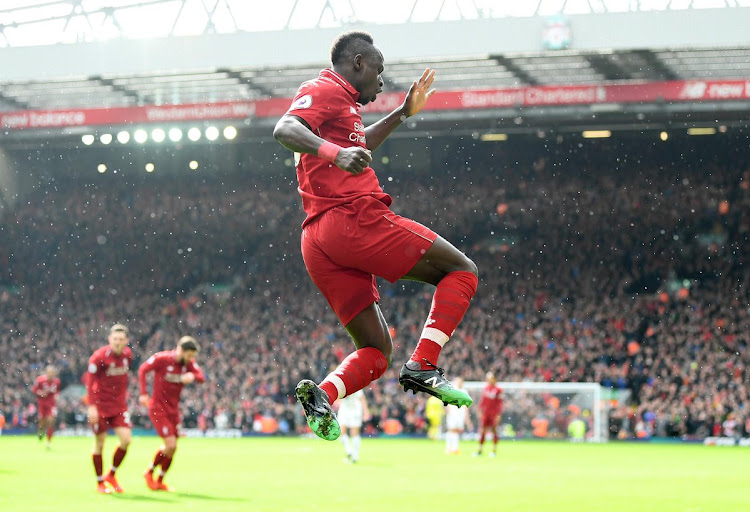 Liverpool's Senegalese forward Sadio Mane celebrates after scoring his second goal during the 4-2 Premier League win over Burnley at Anfield on March 10 2019.