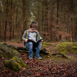Lost in a book by Mike Campbell - Babies & Children Child Portraits ( 2017, reading, finn, announcement, campbell, children, forest, kids, child, january, forest floor, book, woodland, baby, childhood, rachael )