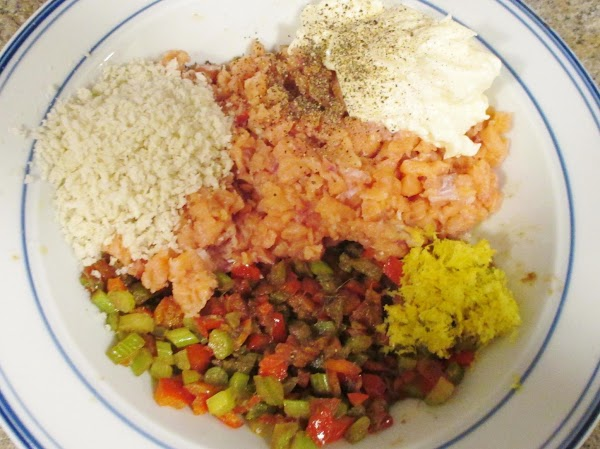 Mix together the salmon, anchovy and vegetable mixture, lemon zest, half (1/4 cup) of...