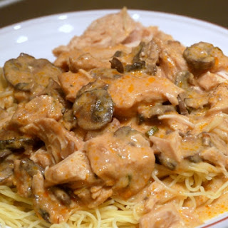 Slow Cooked Super Saucy Chicken over Angel Hair Pasta.