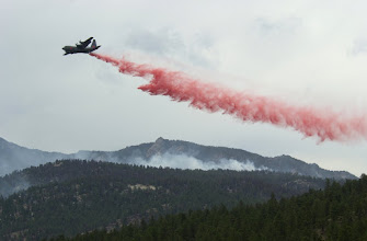 Photo: Hayman Fire North.  Maffs air tanker drops retardent to help hot shots with direct line construction