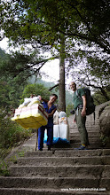 Photo: Porters carry 100 - 200 pounds of supplies up 6 km of stairs