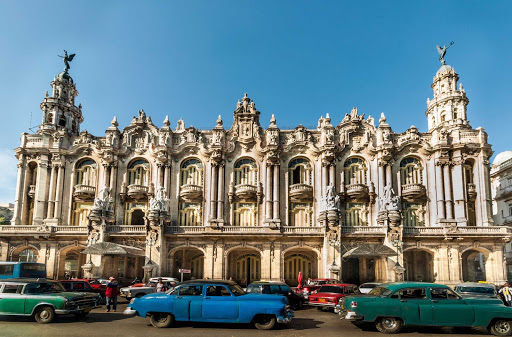 Cuba-Unique-Architecture-and-Colorful-Parked-Cars_01.jpg - The Great Theater of Havana at rush hour.