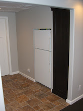 """Photo: Tucked our """"beer fridge"""" into the wall.  Will replace it with a stainless in the future."""