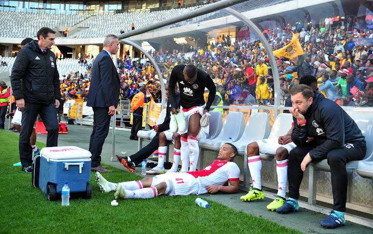 Ajax Cape Town players lie dejected on the bench after the Absa Premiership 2017/18 game against Kaizer Chiefs at Cape Town Stadium on 12 May 2018. Ajax lost 2-1. The Cape side needed a win to avoid playing in the relegation/promotional play-offs against Black Leopards and Jomo Cosmos.