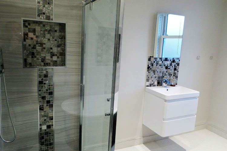 a bathroom with a rebuilt shower