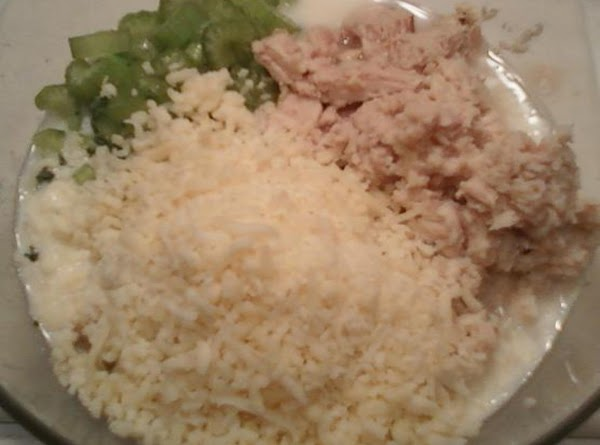 In a large bowl, combine the tuna, and the remainder of ingredients, except bread...