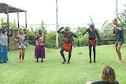 Tourists take part in a traditional dance on the Tiwi Islands, Australia.