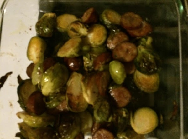 Melt the coconut oil and toss with the brussels sprouts coating them.