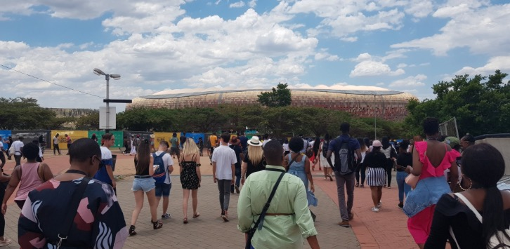 People flock to FNB Stadium in Johannesburg on Sunday for the Global Citizen Festival. Afterwards, late at night, many were left stranded when taxis were not available, Uber apps failed to work and the taxi fares surged.