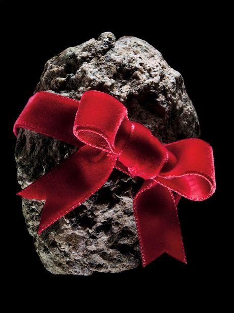 Rock wrapped in red velvet ribbon