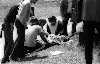 Photo: Injured John Cleary assisted by students.