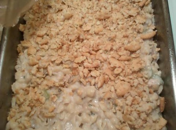 Combine pasta with tuna/soup mixture.  Spoon into 9x13 pan and top with bread...